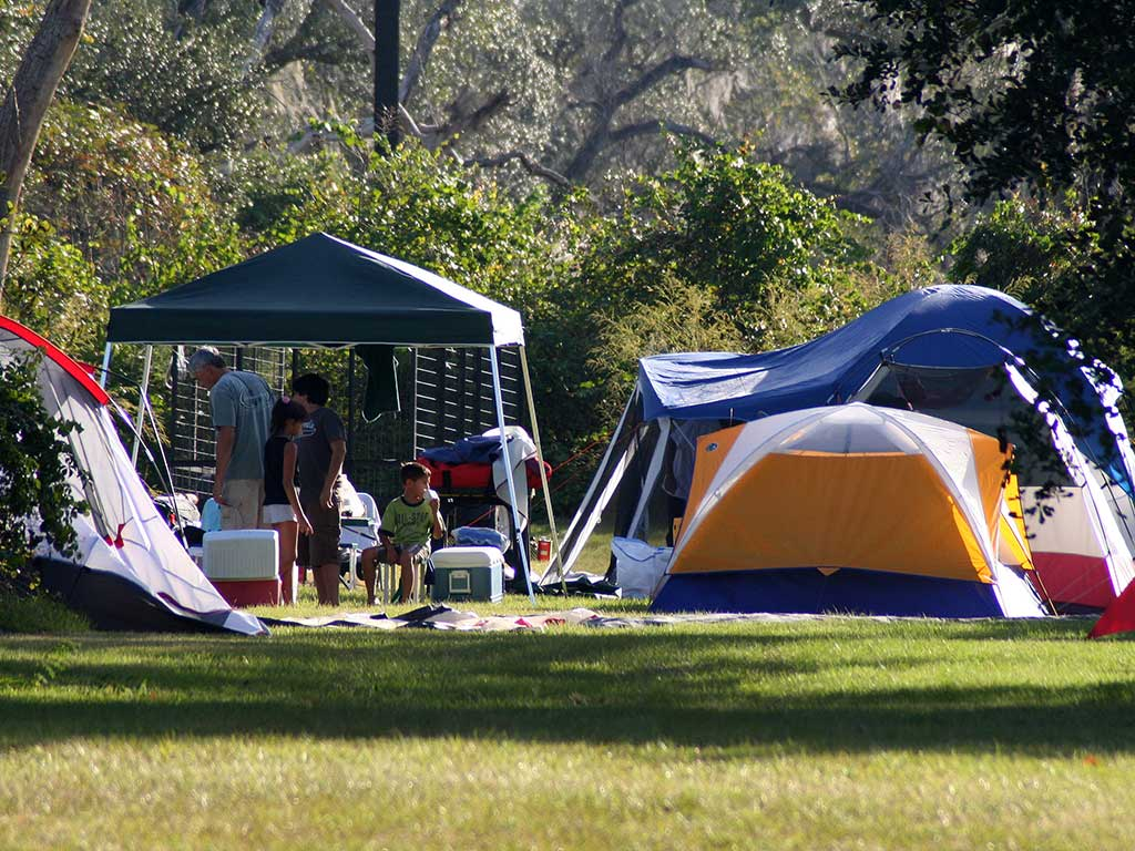 Hispanic family camping in the woods.